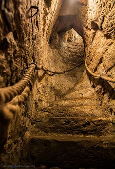 Stairs leading down to the Dungeon at Chirk Castle, Chirk, Wrexham, Wales, UK.  The castle was built in 1295 by Roger Mortimer de Chirk to guard the entrance to the Ceiriog Valley.  Photo: flickr.com/photos/97383585