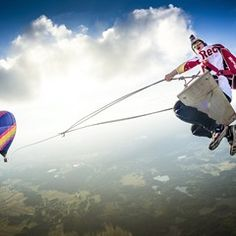 Red Bull Skydive Team perform Mega Swing stunt