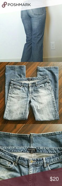 """Banana Republic low-rise, boot cut jeans Banana Republic low-rise, boot cut jeans. Jeans are in great shape. Some wear towards bottom hem where pants were rolled (shown in 3rd picture). Hems look good. Size 6 with 32.5"""" inseam. Banana Republic Jeans Boot Cut"""