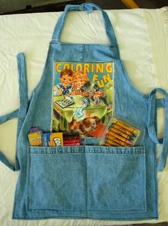 Turn those old jeans into a childs crafting apron!  --Courtesy of Rhonda Regimbal from the Great Falls Goodwill Store
