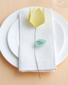 Folded-flower place cards are easily made using origami paper.