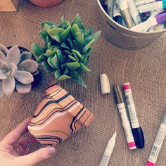Markers are an easy way to give plain terra cotta pots a custom touch.