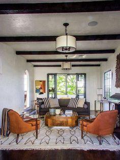 Living room, wood beams, orange midcentury modern chairs