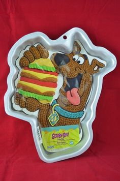 "Wilton Cake Pan  Style: Scooby-Doo!  Item# 2105-3227  Size: 12"" x 11"" x 1-3/4""  Condition: Gently Used"