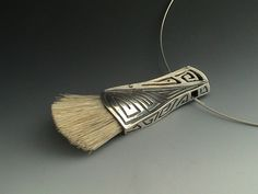"""""""Now, Paint the Town Red"""" Metal clay, Faux Bone, and natural Boar Bristles - 2008  by Angela B Crispin"""