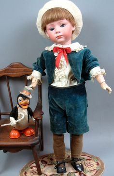 Sweet 20 Gebruder Heubach 7246 Pouty Character Antique Child C. 1912 Plus A Vintage Wind Up Toy Duck! Old Dolls, Antique Dolls, Vintage Dolls, Antique Pictures, Doll Display, Bisque Doll, Boy Doll, Beautiful Dolls, Doll Toys