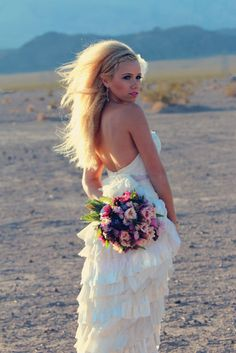 This beautiful bride was captured by Persian Kitty Kat Photography for her wedding in the desert.  More Here: http://snapknot.com/wedding-photographer/3818-Persian-Kitty-Kat-Photography-Wedding-Planning