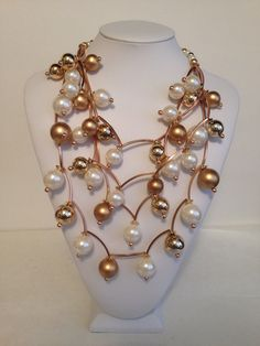 Gold & White Pearl Necklace on Etsy, $25.00>>> im sure it's not real pearl but it's pretty...