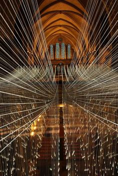 A light installation called Light Showers has been installed in Salisbury Cathedral by artist Bruce Munro. It took five days to complete with two thousand teardrop diffusers, each set at the end of a fibre optic thread, cascading down from the spire. The lights will be officially turned on for the public on November 29th, and will remain in place until January 2011