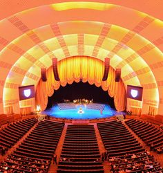 Radio City Music Hall is an entertainment venue located in Rockefeller Center in New York City. Its interior was declared a city landmark in It is a stunning example of Art Deco Architecture. Rockefeller Center, A New York Minute, Art Deco, Radio City Music Hall, Concrete Jungle, New York Jets, Concert Hall, Travel Destinations, Around The Worlds