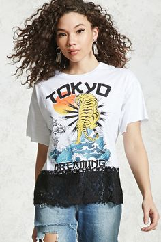"A slub knit tee featuring front ""Tokyo Dreaming"" and tiger graphics, a ribbed crew neck, raw-cut short sleeves, a boxy silhouette, and a contrast lace hem."