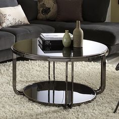 @Overstock.com - Edison Black Nickel Plated Castered Modern Round Coffee Table - This collection has black nickel plating frames inset with black tempered glass. Perfect for showcasing collectibles or displaying books, this coffee table has streamlined shapes that work great in smaller spaces.  http://www.overstock.com/Home-Garden/Edison-Black-Nickel-Plated-Castered-Modern-Round-Coffee-Table/7502659/product.html?CID=214117 $213.20