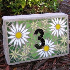 Daisy Stained Glass Mosaic and Concrete House Number by MosaicSmith (Linda), via Flickr