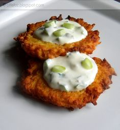 Hungarian potato cakes. -'Tócsni' or 'Macok' or 'Lepcsánka' diferent Hungarian names for the dish. Ingridients are potato, flour, garlic, salt and pepper , fried in oil.