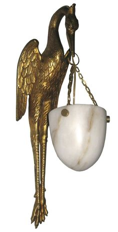 """Pair French Art Deco Bronze Dore and Alabaster Stork Wall Sconces +++   This superbly crafted pair of French art deco sconces date from the 1920s and are fashioned as a pair of storks.  Constructed of bronze with a gold dore finish, each bird holds an illuminated alabaster shade.  Each sconce is 16"""" high, 5"""" wide and projects 7"""" from the wall."""