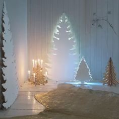 Make a magical Christmas tree scene using saw and plywood cutouts backed with light