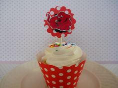 Clifford cupcake wraps and matching decoration toppers make plain cupcakes extra special!  Contact us to order.  $1.00