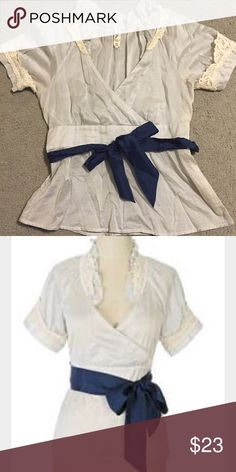 """Floreat Blouse  Lovely Floreat (anthropologie) wrap blouse with navy tie. Adorable lace details. Needs a cami for modesty due to low neckline and sheerness but lots of styling options with this one! Bust 19"""", length 21"""". Anthropologie Tops Blouses"""