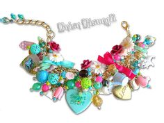 GIRLY GARDENING charm bracelet    One-of-a-kind bracelet featuring a selection of plastic, vintage, czech glass and semiprecious stone beads and charms.