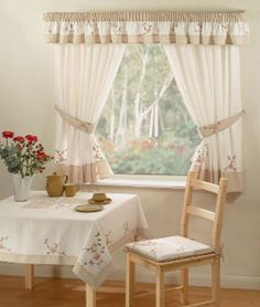 Kitchen Curtains; Two Rod; Valance on Outside Rod, Tier and Tie Back on Inside Rod.