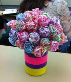 Teach a round design. Use a vegetable can, duck tape to decorate, and dum dum suckers! Very cheap and easy!