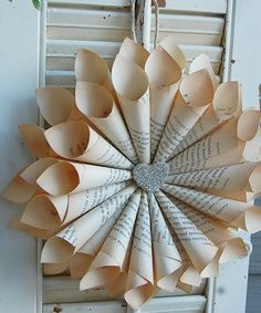 Paper book wreath - I don't like the heart but I love this. . . dining room? What could I sub out for the heart?