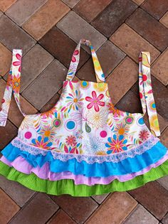 I love the ruffles on this little adorable handmade apron. The perfect accessory for a little chef. How cute is that little pink lace accent?