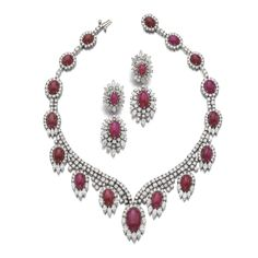 Ruby and diamond demi-parure Comprising: a necklace set with cabochon rubies, marquise-shaped and brilliant-cut diamonds, length approximately 405mm, signed E. Pearl, and a pair of earrings, one signed E. Pearl, post and hinged back fittings.