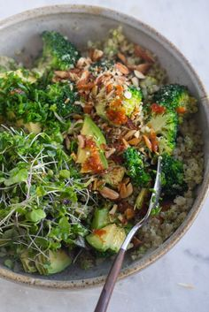 Vibrant Vegan Double Broccoli Buddha Bowl  	  - A favorite Buddha bowl made with seven ingredients on green overdrive. You double up on broccoli through a coconut green curry pesto and florets, then toss with a quinoa base. - from 101Cookbooks.com