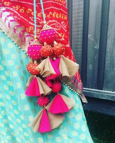 The ultimate list of gorgeous Lehenga and Blouse Latkan designs that are ruling the internet. From tassels to pom-pom designs, choose not just one but more. Stylish Blouse Design, Fancy Blouse Designs, Blouse Neck Designs, Saree Tassels Designs, Diy Tassel, Fabric Jewelry, Churidar, Handmade, Internet