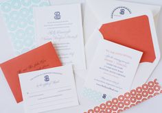 coral wedding invitation with mint green and navy accents