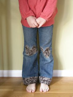 This is a creative solution for pants that have holes in the knees and are too short. patching kids' pants