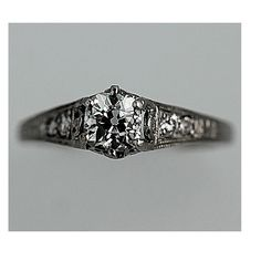 Hey, I found this really awesome Etsy listing at http://www.etsy.com/listing/113129703/antique-platinum-old-miner-cut-diamond