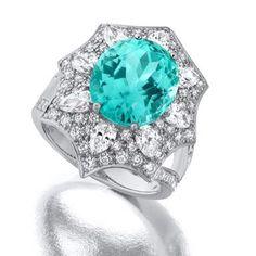 Suna Bros. stunning platinum ring featuring a 6.19 ct. Paraiba Tourmaline…