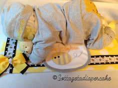 bee diapercake, Sleeping diaper babies,diaper cakes, baby shower, center piece, boy diaper baby, girl diaper baby, baby gifts, unique gifts, by Gottagetadiapercake on Etsy https://www.etsy.com/listing/161501537/bee-diapercake-sleeping-diaper
