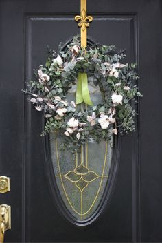 Eucalyptus wreath adorned with faux cotton picks for that light spring touch.
