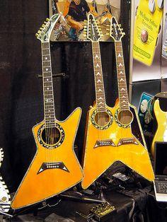 Somebody had to do it. Now we can cross it off the list. Dommenget Acoustic Explorer and Doubleneck Flying V - 2010 NAMM