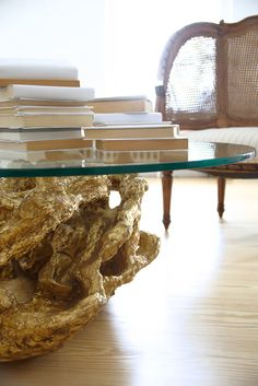 reclaimed stump turned coffee table with a splatter of gold