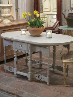 This table a volets dates from the 19th century. Fully restored and painted, this beech table has two drawers and both sides can be dropped down, making it possible to put against a wall. A table such as this would typically have been used in the kitchen to prepare desserts for a dinner party or for a casual family dinner. The high quality and detail of the workmanship makes this table a rare find.