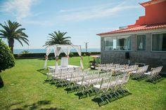 White Canopy and white wooden chairs - destination wedding celebration by the Sea #destinationweddingsinportigal #weddingceremonyportugal