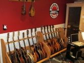 This man-cave is well organized thanks to the Session™ #Guitar Stands and two ukeleles in the Pro-File™ wall mounted guitar hangers from http://www.GuitarStorage.com