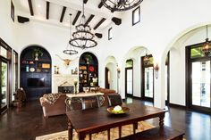 Hacienda Love the natural light, high ceilings, arches, french doors, and beams! Needs color! Spanish Colonial Decor, Spanish Style Homes, Spanish Revival, Mediterranean Living Rooms, Mediterranean Decor, Beautiful Living Rooms, Custom Home Builders, Farmhouse Design, House Styles
