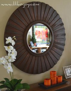 DIY sunburst mirror made of wood shims - much prettier than the skewer version