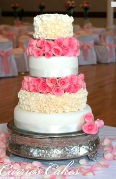 White pink and cream floral wedding cake.