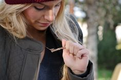 t-girl shows off her anme necklace