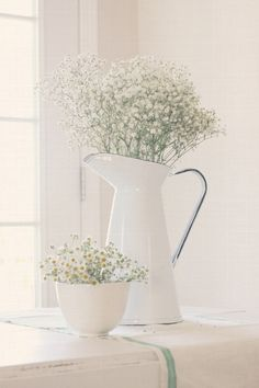 Proof of concept: enamel pitcher with baby's breath.