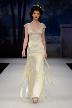 TOULOUSE by Claire Pettibone.  Spring 2012  Ivory embroidery lined in platinum silk with sweetheart neckline and silk bows and silver flowers at the hips.