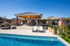 This fabulous pool and outdoor entertaining area has been created from a simple lawn backyard.  Such an inviting space for those hot Brisbane days.