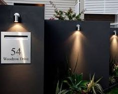 7 Ways to Transform an Ugly Garden Wall Modern Exterior by Klinge Constructions and Developments Modern Exterior, Exterior Design, Illuminated House Numbers, House Number Plates, Gate Lights, Name Plate Design, Compound Wall, Vertical Garden Design, Paint Your House