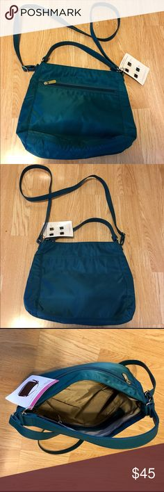 """Thirty-One Everything Crossbody Everything Crossbody      Zipper closure, front zipper pocket, back flat pocket with magnetic snap closure, attached crossbody strap and satchel strap, 2 interior flat pockets and 1 zipper pocket 11.75""""H, 11.75""""L, 4.5""""D  Pattern:  Teal Affair Thirty-One Bags Crossbody Bags"""
